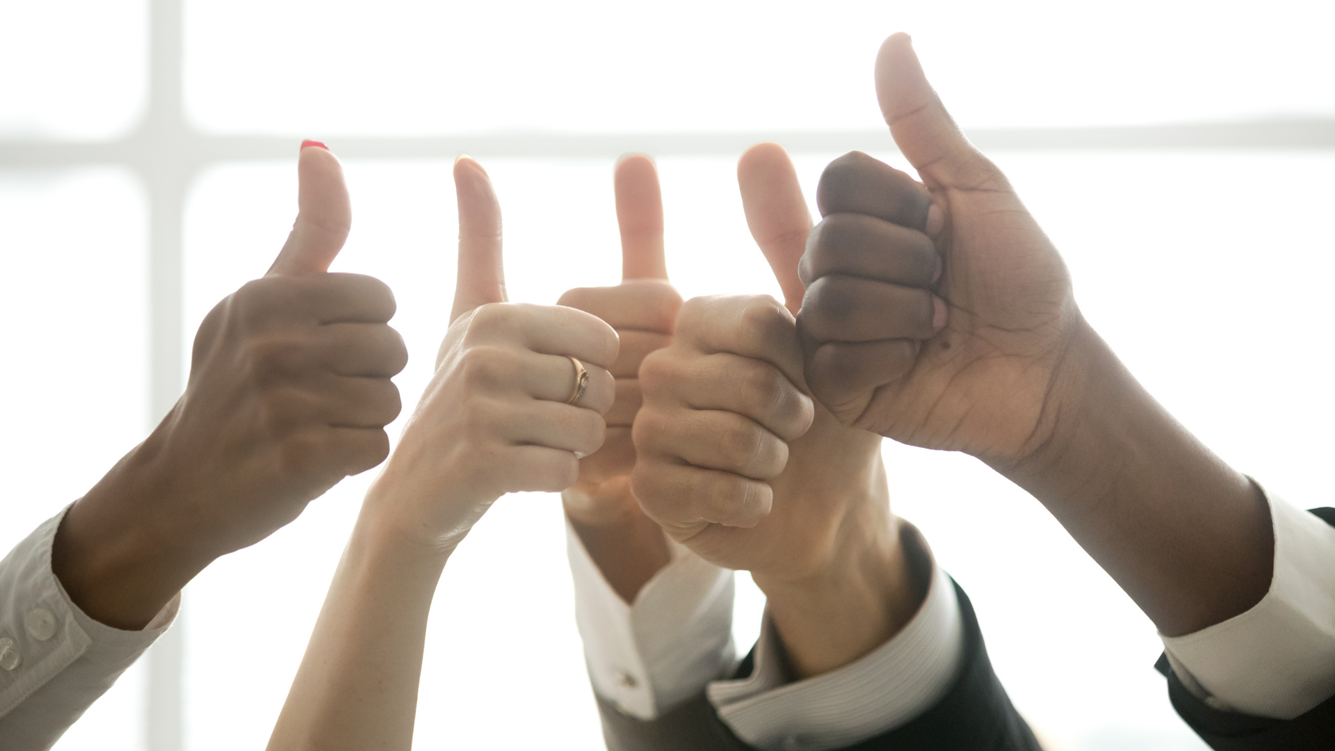 employees hands with thumbs up